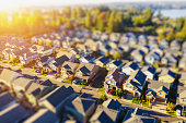 Aerial photo of an American suburban neighborhood with a tilt-shift effect at sunset