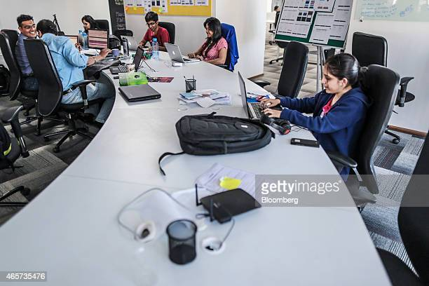 Tiny Owl employees work on laptop computers inside the company's head office in Mumbai India on Monday March 9 2015 Tiny Owl is a smartphone...