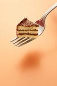 """""""Tiny piece of cake on a fork.  This is not a composite photo. I actually baked a tiny cake with three layers, frosted it, decorated it, cut a slice out with a tiny knife, and put it on the fork.Great"""