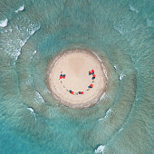 aerial beach view with red shades as a tiny planet