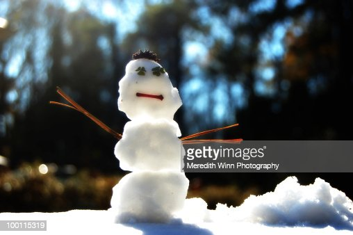 Tiny snowman with clover eyes : Stock-Foto