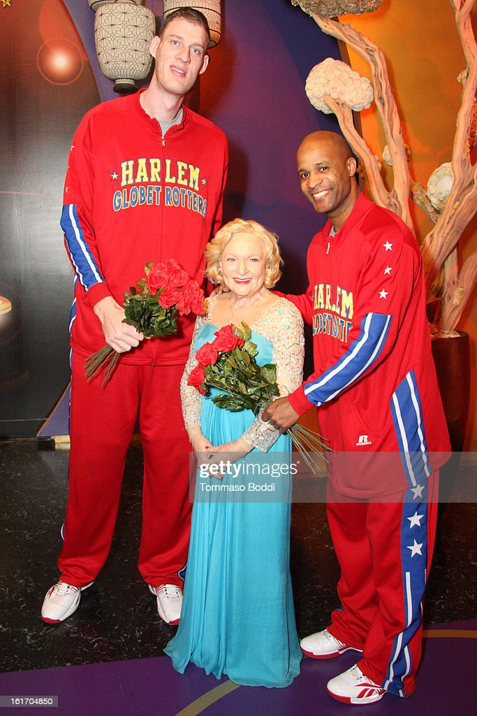 Tiny Sturgess (L) and Herbert 'Flight Time' Lang make an appearance alongside a model of actress Betty White at world's most famous Madame Tussauds Wax Museum on February 14, 2013 in Hollywood, California.