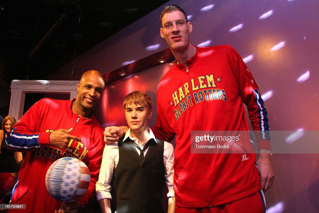 Tiny Sturgess (R) and Herbert 'Flight Time' Lang make an appearance alongside a model of Justin Bieber at world's most famous Madame Tussauds Wax Museum on February 14, 2013 in Hollywood, California.