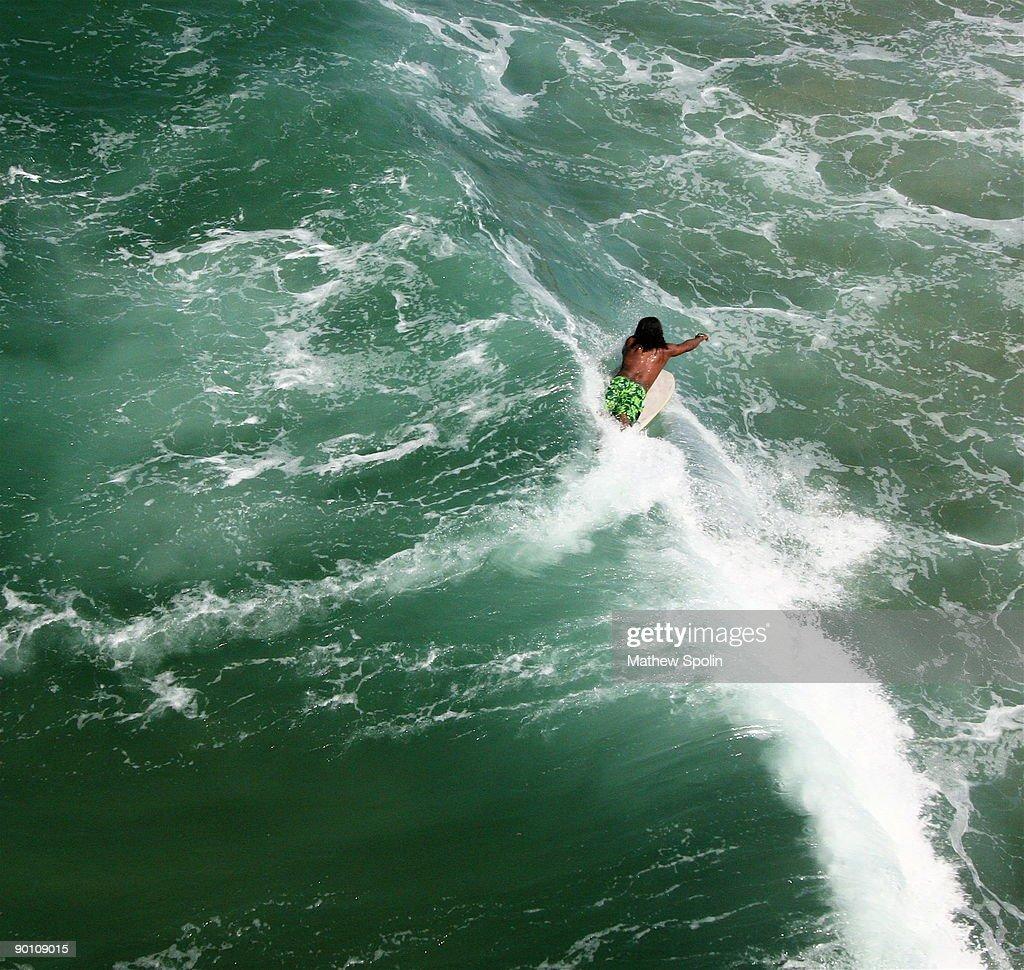 Tiny Surfer : Stock Photo