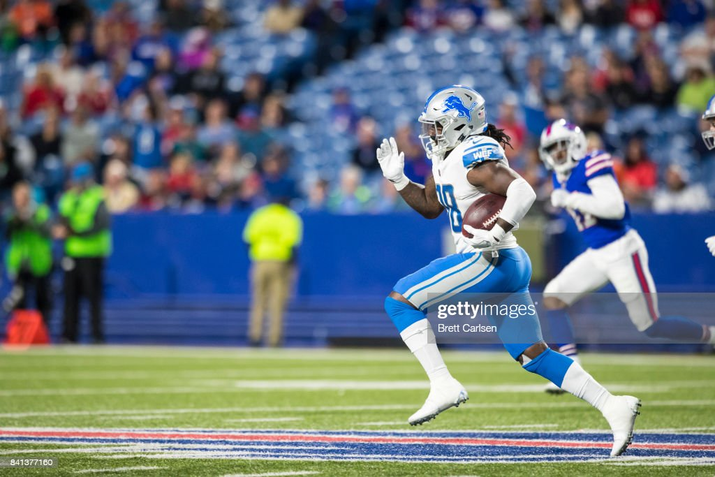 Tion Green #38 of the Detroit Lions carries the ball for a touchdown during the second half against the Buffalo Bills on August 31, 2017 at New Era Field in Orchard Park, New York. Buffalo wins the preseason matchup over Detroit 27-17.