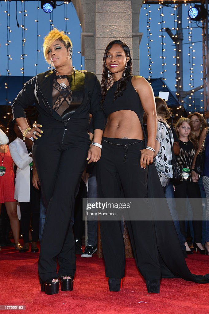 Tionne 'TBoz' Watkins and Rozonda 'Chilli' Thomas of TLC attend the 2013 MTV Video Music Awards at the Barclays Center on August 25 2013 in the...