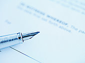 Tip of fountain pen laying on paper