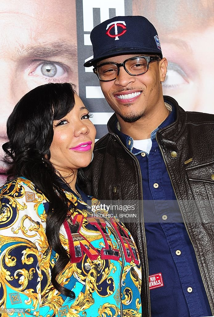 Tip 'T.I' Harris and his wife Tameka Cottle pose on arrival for the world premiere of the film 'Identity Thief' in Los Angeles, California, on February 4, 2013. The film opens nationwide on February 8. AFP PHOTO / Frederic J. BROWN