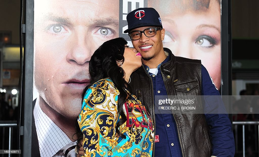 Tip 'T.I' Harris receives a kiss from his wife Tameka Cottle while posing on arrival for the world premiere of the film 'Identity Thief' in Los Angeles, California, on February 4, 2013. The film opens nationwide on February 8. AFP PHOTO / Frederic J. BROWN