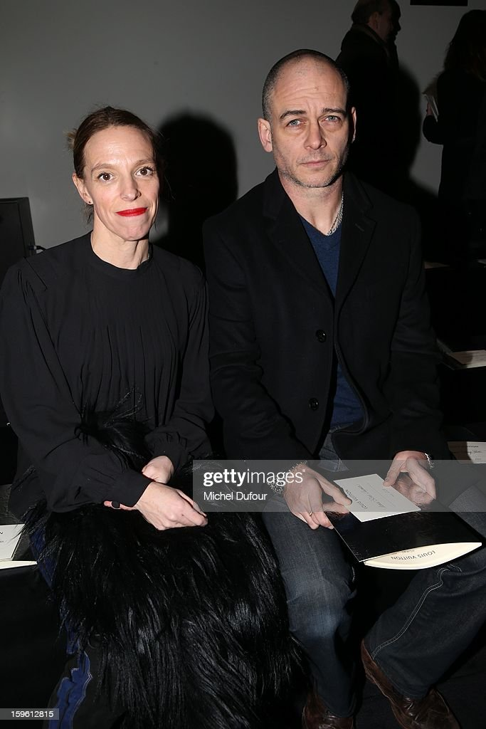 Tiphaine and Dino Chapman attend the Louis Vuitton Men Autumn / Winter 2013 show as part of Paris Fashion Week on January 17, 2013 in Paris, France.