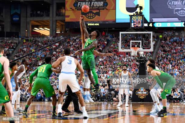 Tipoff against Jordan Bell of the Oregon Ducks and Isaiah Hicks of the North Carolina Tar Heels during the 2017 NCAA Men's Final Four Semifinal at...