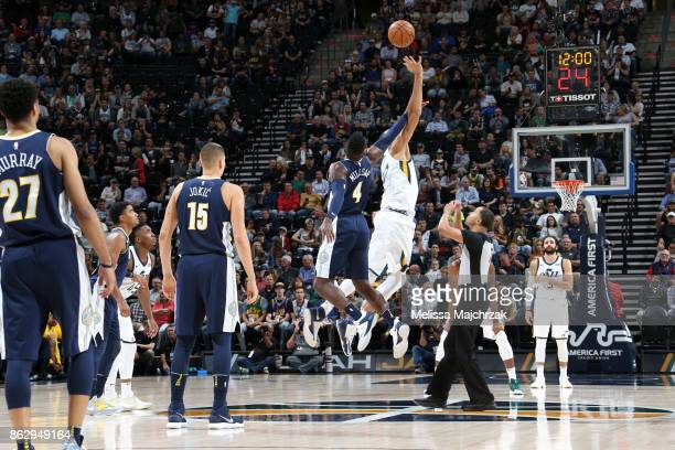 Tipoff between Paul Millsap of the Denver Nuggets and Rudy Gobert of the Utah Jazz to start the season game on October 18 2017 at Vivint Smart Home...