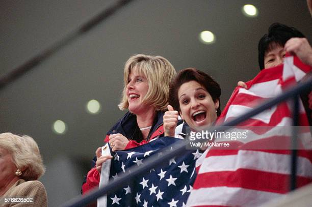 Tipper Gore and Mary Lou Retton hold the American flag while they watch the free skate program in White Ring during the 1998 Winter Olympic games