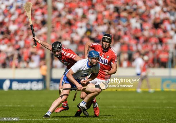 Tipperary Ireland 18 June 2017 Michael Walsh of Waterford in action against Colm Spillane left and Mark Ellis of Cork during the Munster GAA Hurling...