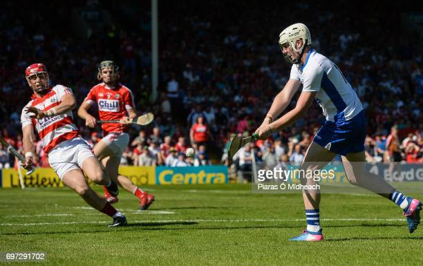 Tipperary Ireland 18 June 2017 Shane Bennett of Waterford shoots wide under pressure from Anthony Nash of Cork early in the first half during the...