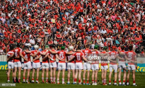 Tipperary Ireland 18 June 2017 Supporters and the Cork team stand for the National Anthem before the Munster GAA Hurling Senior Championship...