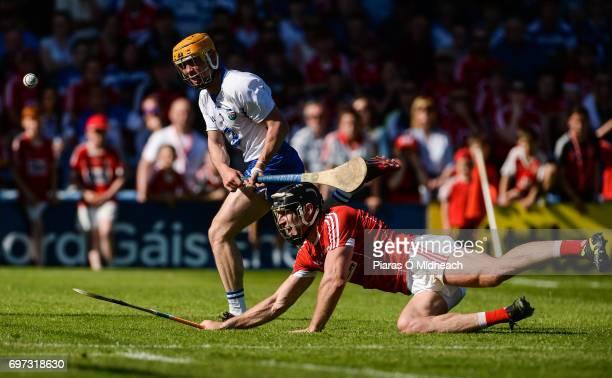 Tipperary Ireland 18 June 2017 Tommy Ryan of Waterford shoots under pressure from Mark Ellis of Cork during the Munster GAA Hurling Senior...