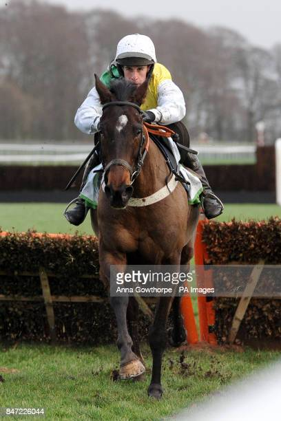 Tippering ridden by Henry Oliver during the Play Online Now At StanJamescom Casino Handicap Hurdle