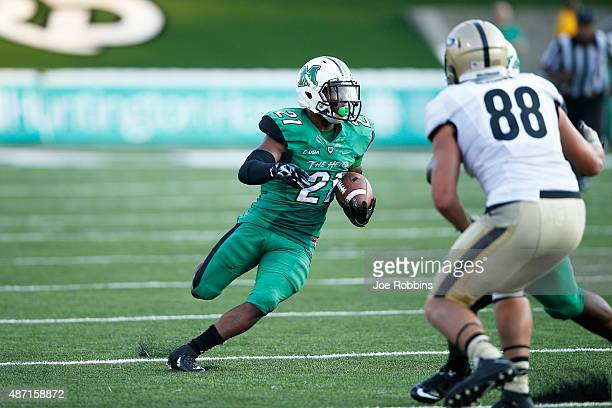 Tiquan Lang of the Marshall Thundering Herd returns an interception for a touchdown late in the second half against the Purdue Boilermakers at Joan C...