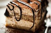 Coffee-flavoured Italian Tiramisu Cake with chocolate dressing on top.