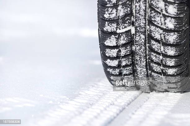 A tire leaving tracks in the snow
