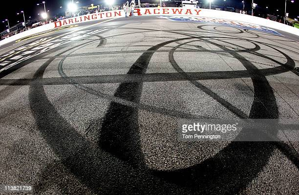 Tire marks are seen near the finishline after Kyle Busch driver of the ZLine Designs Toyota performed a burnout in celebration of his win after the...