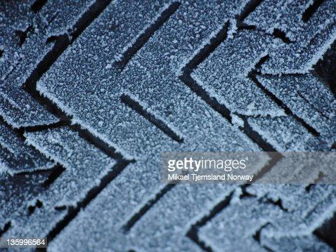 Tire pattern on old tire covered in frost