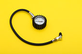 Tire Pressure Gauge on yellow background