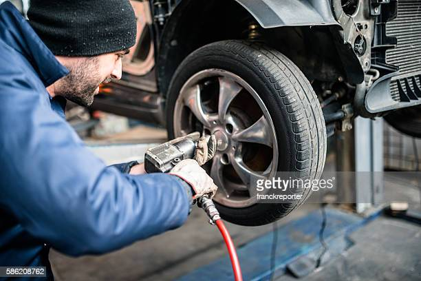 tire repairer changing the car tire