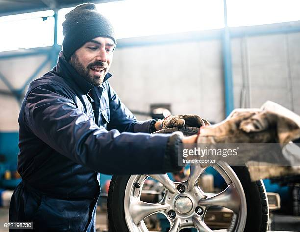 tire repairer cleaning the wheel