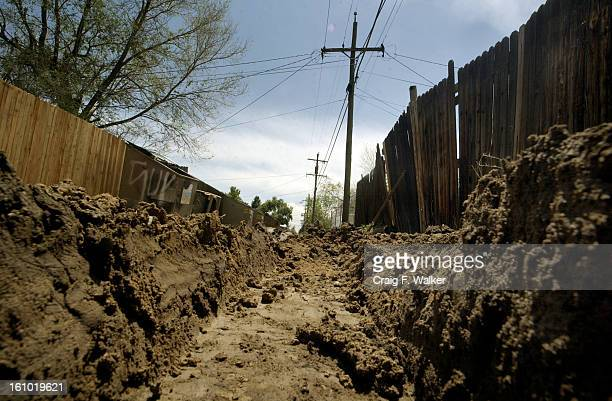 Tire ruts are deep in the mud of this alley between Stuart St and Raleigh St just south of Alameda in Denver CO Craig Walker 303 870 1894
