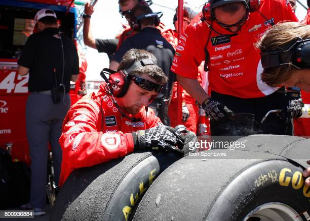 Tire specialist for Kyle Larson measures tire wear after his pit stop at the NASCAR Monster Energy Cup Series Toyota/Save Mart 350 on June 25 2017 at...