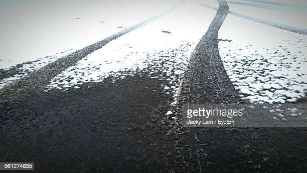 Tire Track Imprint On Snow Covered Mud Road