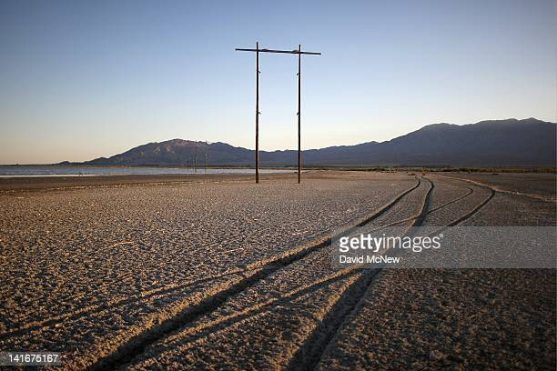 Tire tracks cross the soft mud of the shore of the Salton Sea in an area where a controversial development would create a new town for nearly 40000...