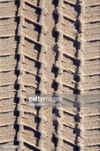 Tire tracks in sand : Stock Photo