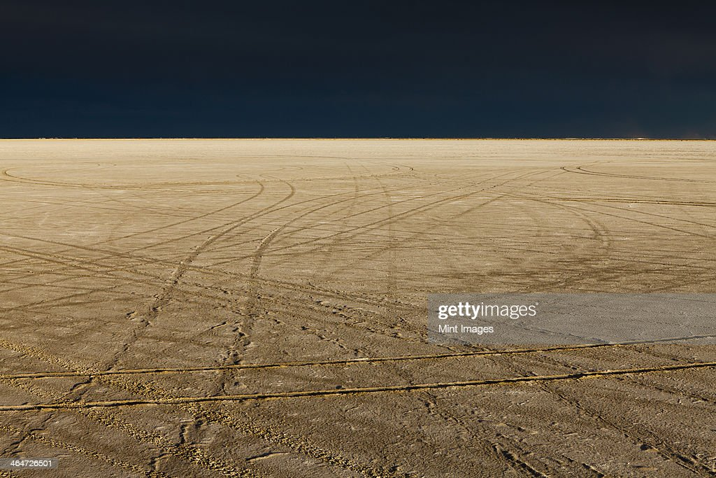 Tire tracks on the Bonneville Salt Flats. Speed Week. A dark stormy sky.