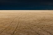 Tire tracks on the Bonneville Salt Flats. Speed Week. A dark stormy sky.