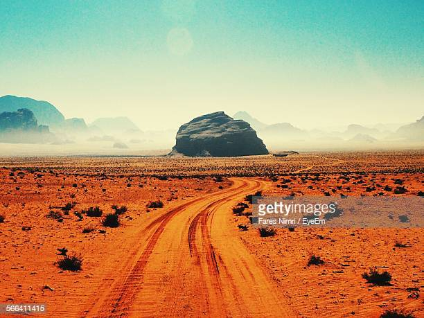 Tire Tracks On Wadi Rum Desert Against Clear Sky