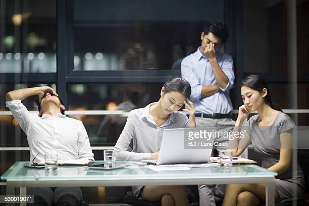 Tired business people having a meeting
