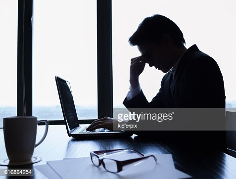Tired businessman at the office : Stock Photo
