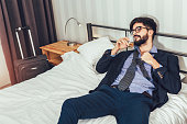 Tired Businessman resting in hotel room