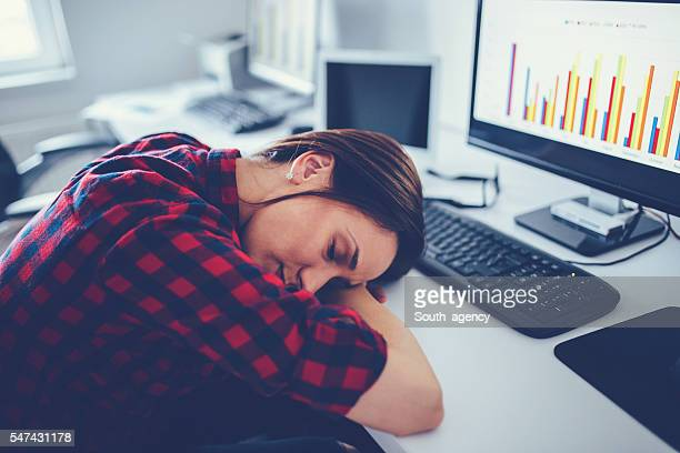 Tired businesswoman sleeping on the desk