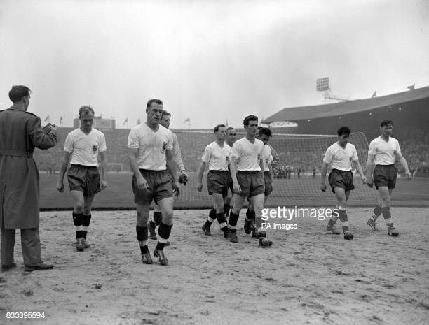 Tired but victorious England players walk off the pitch at Wembley after the match beating the USSR 50 Don Howe Nat Lofthouse Colin McDonald Tom...