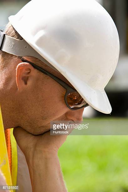Tired construction worker, close-up