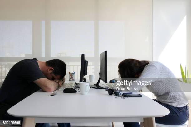 Tired couple work together in home office