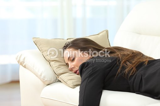 Tired executive sleeping at home after work : Stock Photo