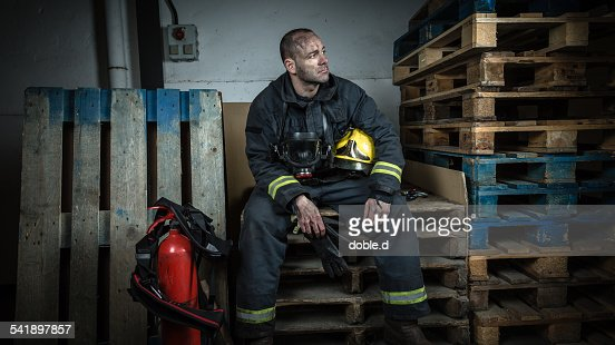 Tired firefighter sitting after a emergency
