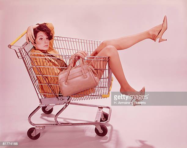 Tired ,frustrated woman in supermarket shopping trolley. (Photo by H. Armstrong Roberts/Retrofile/Getty Images)
