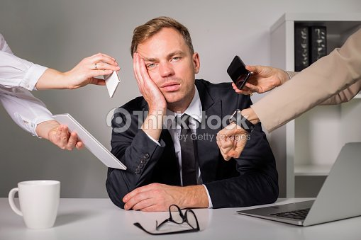 Tired man being overloaded at work : Stock Photo