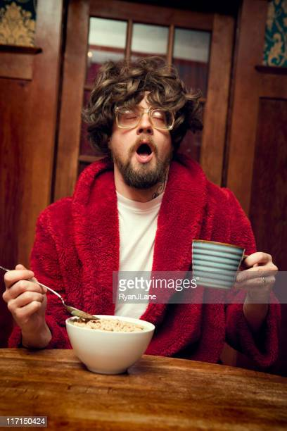 Tired Nerd Man Eating Cereal and Yawning